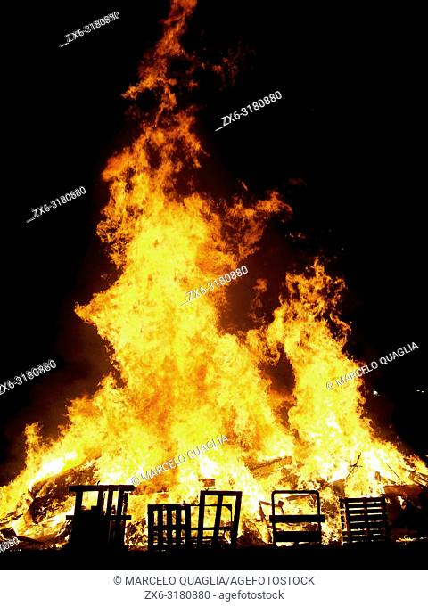 Bonfire of St. John's Night –nit de Sant Joan- to celebrate Summer Solstice arrival at Olost village. Lluçanès region, Barcelona province, Catalonia, Spain