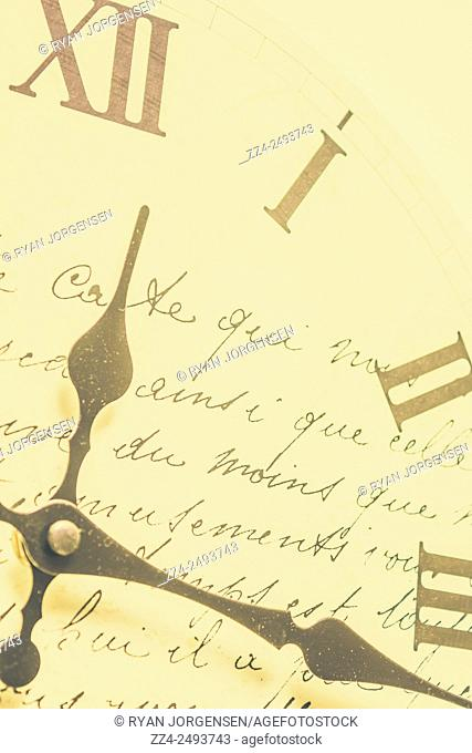 Past time clocks point to 12 on the dial with nostalgic words written in rhyme. Time signatures