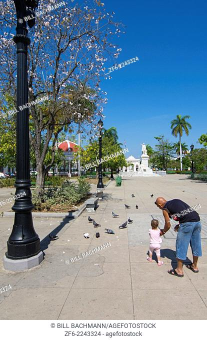 Cienfuegos Cuba center square in city center with girl and Dad feeding birds 9