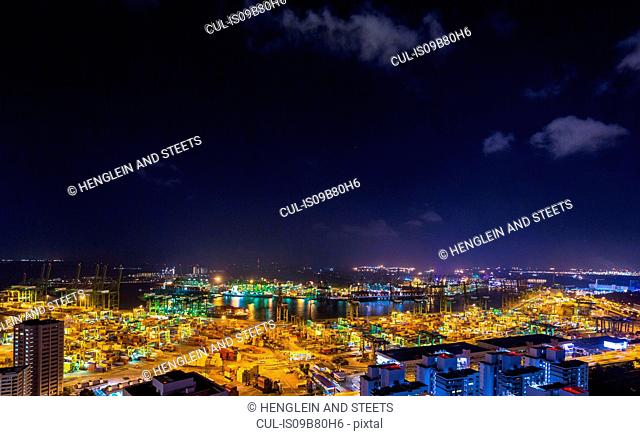 Cityscape with distant view of container terminal at night, Singapore, South East Asia