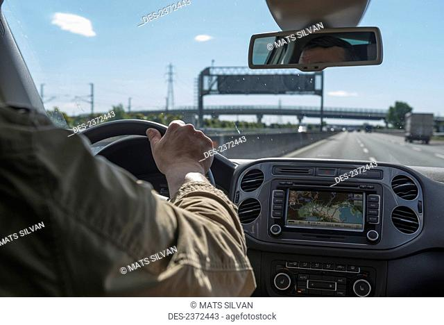 View From Behind The Driver Through The Windshield To The Road; Rimini, Emilia-Romagna, Italy