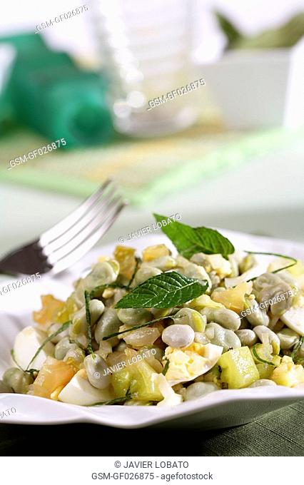 Tender broad beans and hard-boiled eggs salad