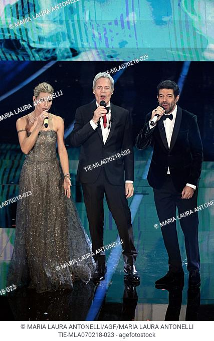 Tv presenter Michelle Hunziker, singer and artistic director of Festival Claudio Baglioni, the actor Pierfrancesco Favino during the 68th Sanremo Music Festival