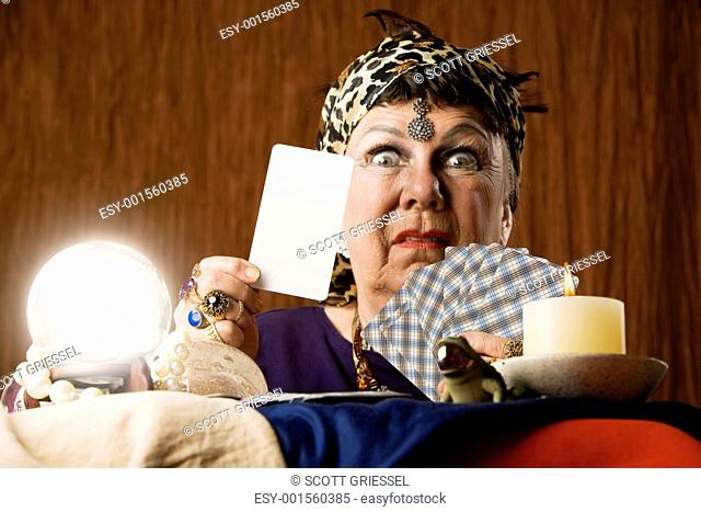 Fortune teller with crystal ball tarot cards Stock Photos