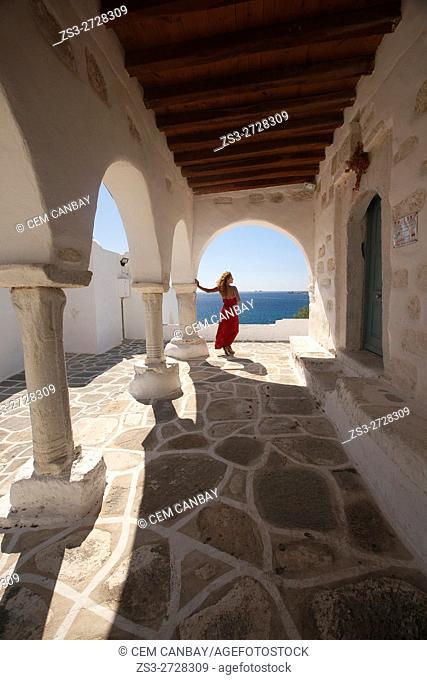 Woman standing near the columns of the main church in Parikia, Paros, Cyclades Islands, Greek Islands, Greece, Europe