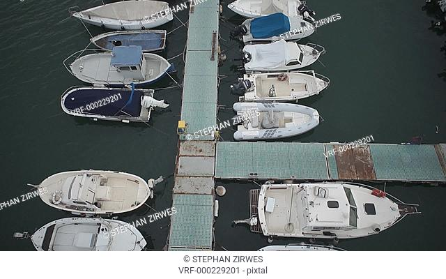 WS POV View of moored motorboats on harbour in Genoa, Italy