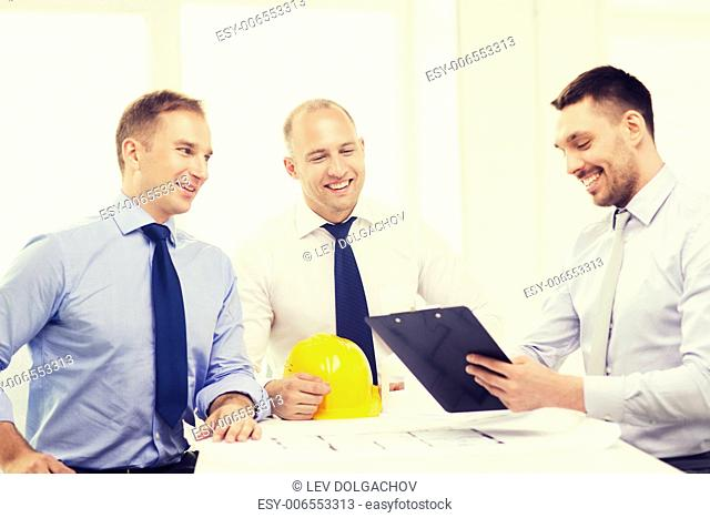 business, architecture and office concept - happy team of architects and designers in office