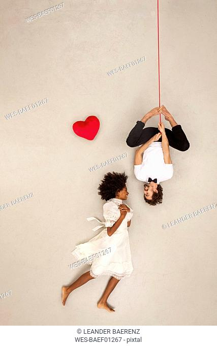 Couple falling in love, man hanging upside down