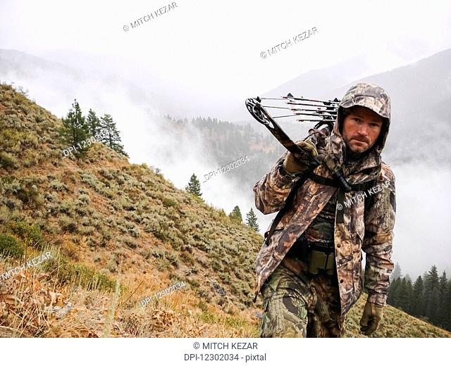 Bowhunter elk hunting in Mountains