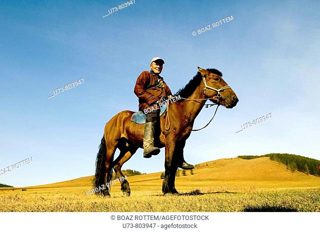 A Mongolian nomads on his horse