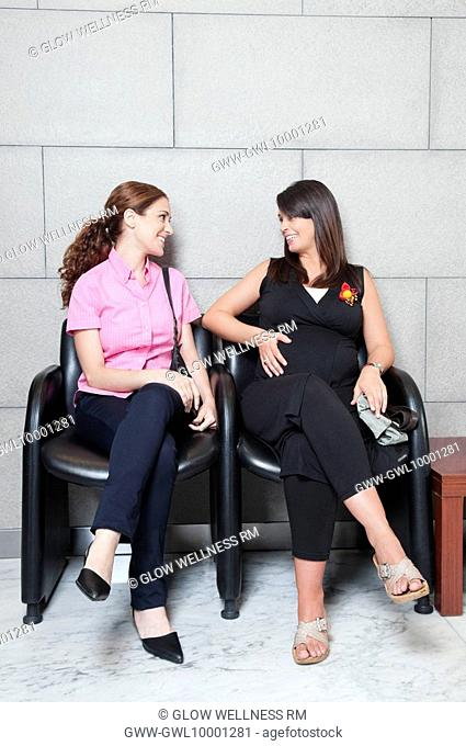 Two women sitting in a hospital waiting room