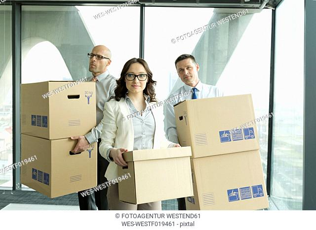 Businesspeople in office with cardboard boxes