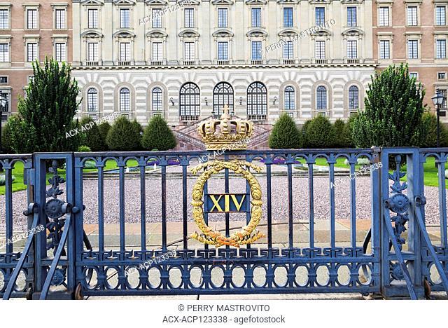 Blue ornate iron gate and Swedish royal palace designed by architect Nicodemus Tessin, Stockholm Sweden, Europe
