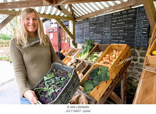 Woman Running Stall Selling Organic Fruit And Vegetables