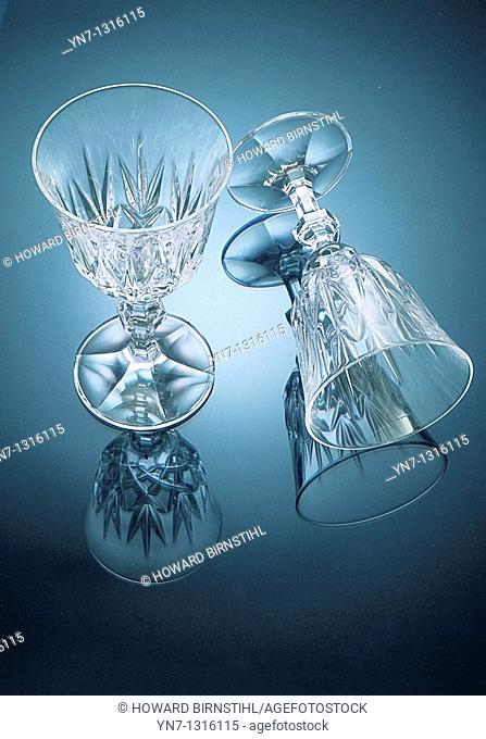 two crystal wine glasses with reflections