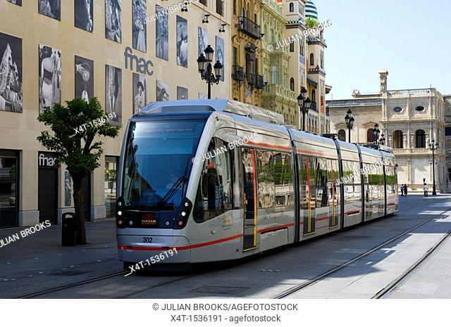 A modern tram in the ancient city of Seville, Spain