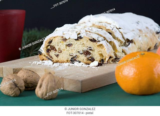 A fruit cake in a Christmas setting