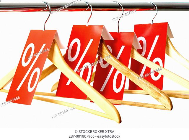 Photo of hangers with red labels showing holiday discount and sale