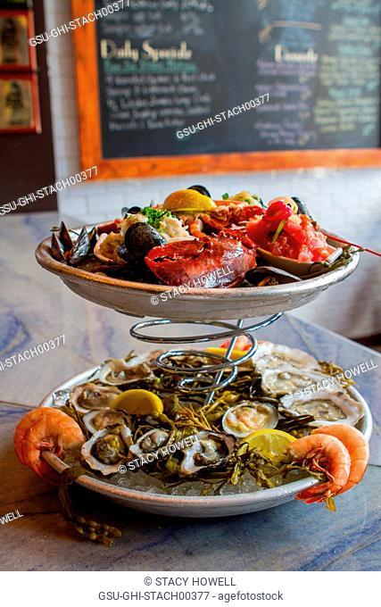 Platters of Raw Oysters on Half-Shell, Mussels, Lobster and Shrimp at Restaurant