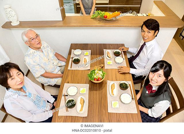 Three generation family at a dining table