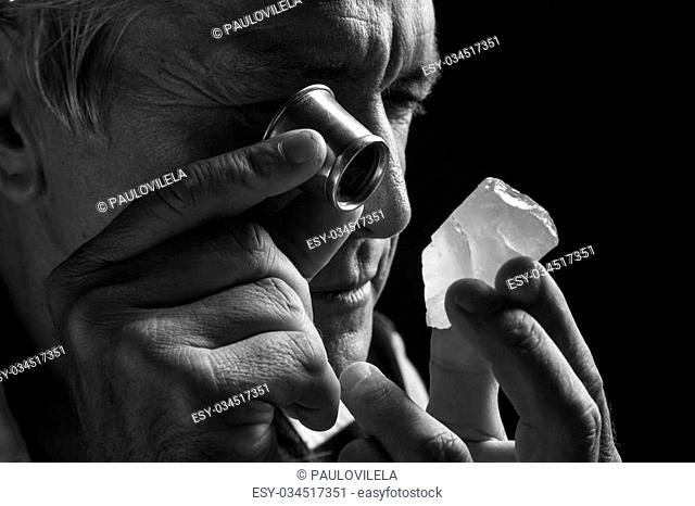 portrait of a jeweler during the evaluation of jewels. Gemstone