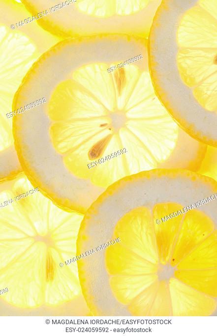 Fresh macro lemon slices background