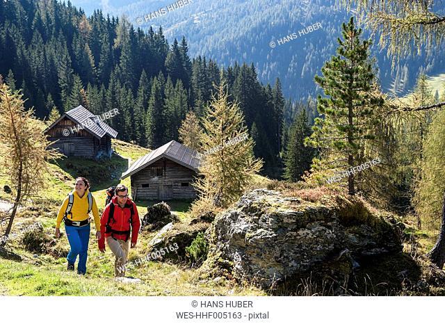 Austria, Altenmarkt-Zauchensee, young couple hiking