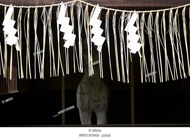 Rope and paper ornaments at Kitano Tenmangu Shrine, Kyoto, Japan