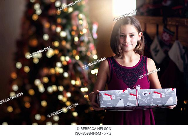 Young girl holding christmas gift