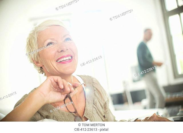 Older woman smiling indoors