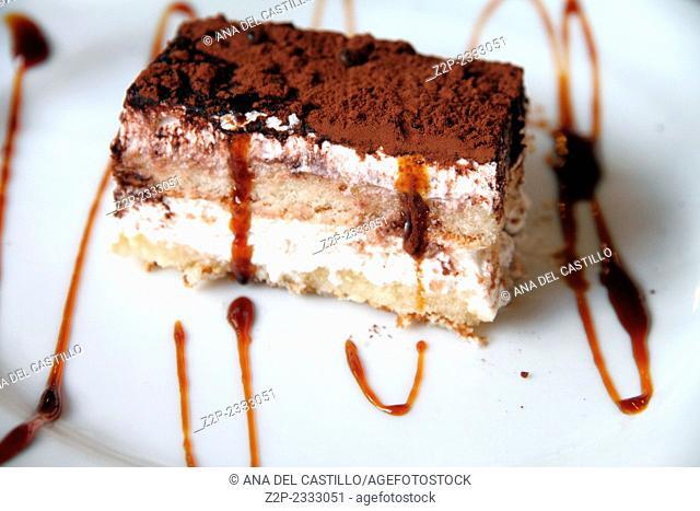 Tiramisu dessert on white plate