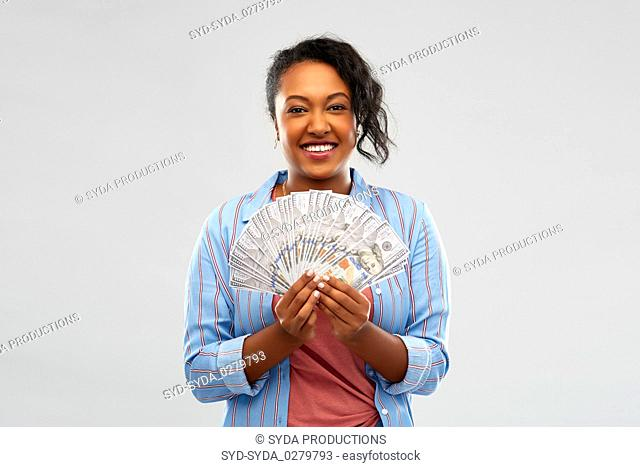 happy african american woman holding dollar money