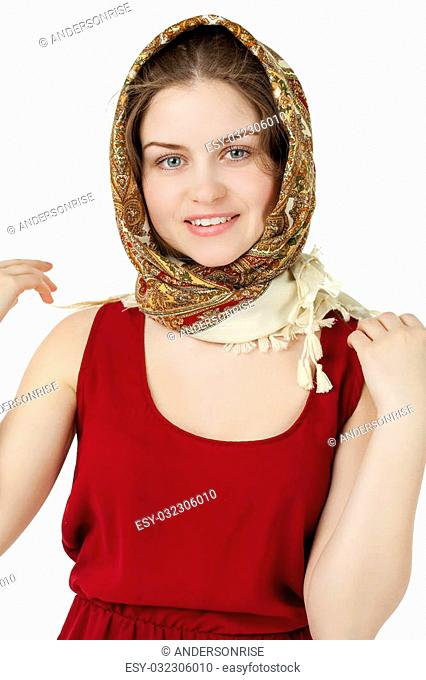 Young blonde woman in a red golden scarf on walk isolated on white background
