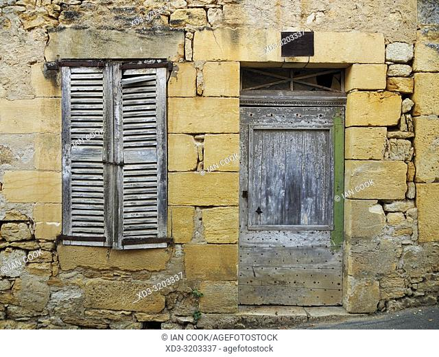shuttered window and door, derelict building, St. Vincent de Cosse, Dordogne Department, Nouvelle Aquitaine, France