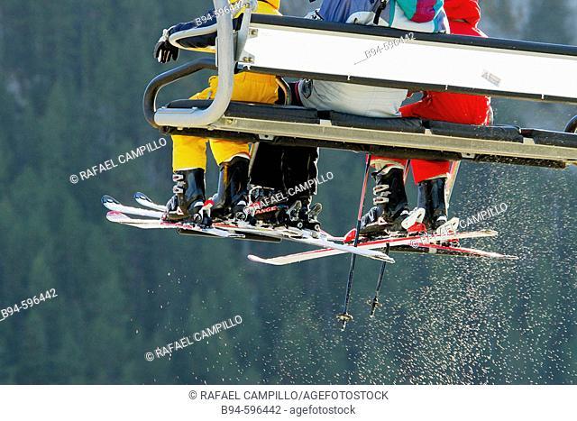 Skiers on chairlift. La Molina ski resort. Cerdanya. Girona. Catalonia, Spain