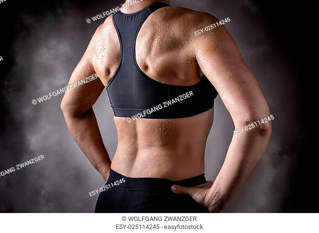 Picture of a trained back of a middle aged woman over 45 years
