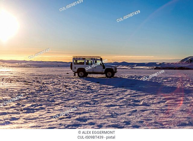 Four wheel drive vehicle in remote landscape, Iceland