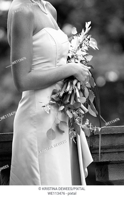 A Bridesmaid holding her bouquet during a wedding