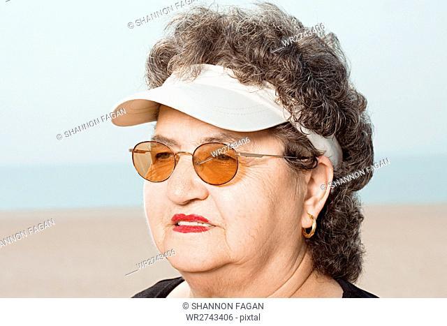 Woman wearing a sun visor