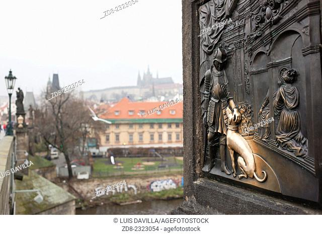 One of the two bronze plaques on the statue of St. John of Nepomuk on Charles Bridge in Prague