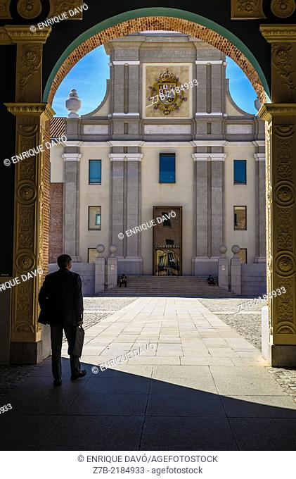 A man in a shadow in the entry of Conde Duque center, Madrid city, Spain