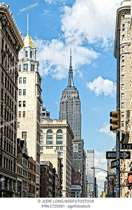 Manhattan, NYC. Looking North up Fifth Avenue from East 20th Street, in the Flatiron District. Empire State Building in the Distance