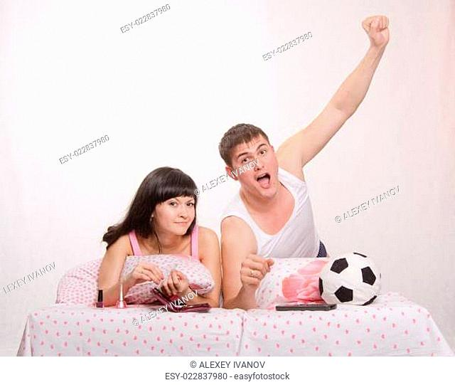 Celebrates after scoring husband, wife watch soccer