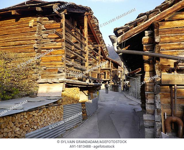 Switzerland, Valais, Val d'Herens, village of Evolene, hamlet of La Sage with wooden 'mazots'