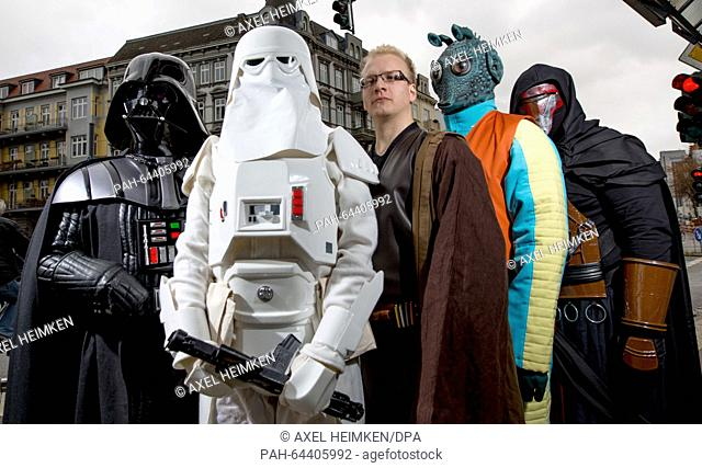 Members of a local 'Star Wars' fan club dressed as characters from the Star Wars movies Darth Vader (l-r), a Snowtrooper, a Jedi Knight