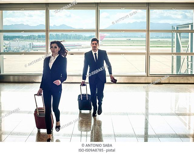 Businesspeople running in airport