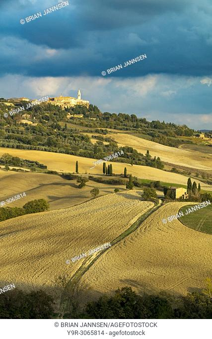 Evening sunlight over town of Pienza and the countryside of Tuscany, Italy