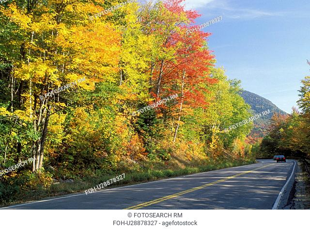 road, NH, New Hampshire, White Mountain National Forest, Merrimack River Valley, Scenic Kancamagus Highway surrounded by colorful fall foliage in the autumn in...