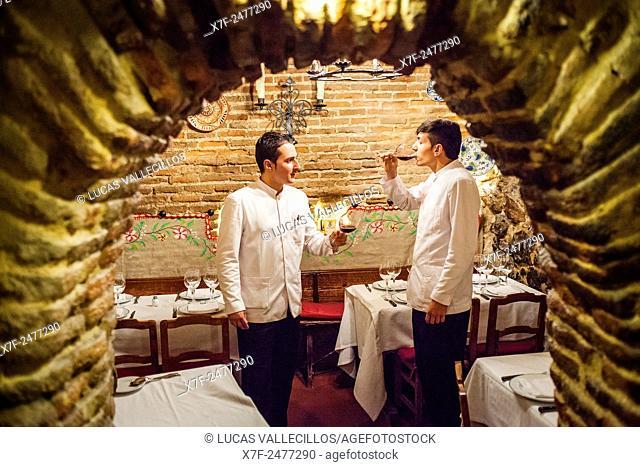 Sobrino de Botin restaurant, waiters, testing the wine, calle Cuchilleros 17. Madrid, Spain