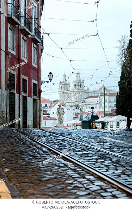 Romantic atmosphere in the old streets of Alfama with the ancient castle in the background Lisbon Portugal Europe